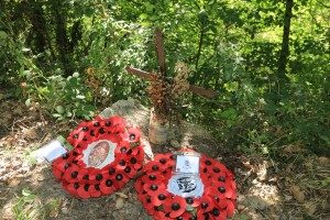 Wreaths laid at a cross honouring the unknown British soldier shot dead at Montelparo