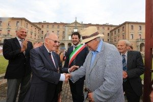Former PoWs Frank Unwin and Michael Lacey formally open the gates of PG 49 camp at Fontanellato. Nick Young, Deputy Mayor Francesco Trivelloni and Michael de Burgh are in the background