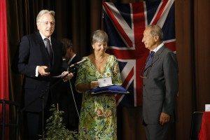 Christopher Prentice, the British ambassador to Rome, and his embassy co9lleague Anita Krol, present the MBE to Antonio Millozzi
